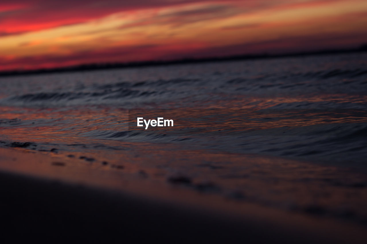 sunset, sky, beauty in nature, water, cloud - sky, scenics - nature, orange color, sea, land, beach, tranquility, nature, no people, tranquil scene, idyllic, wave, horizon, dramatic sky, outdoors, horizon over water, surface level