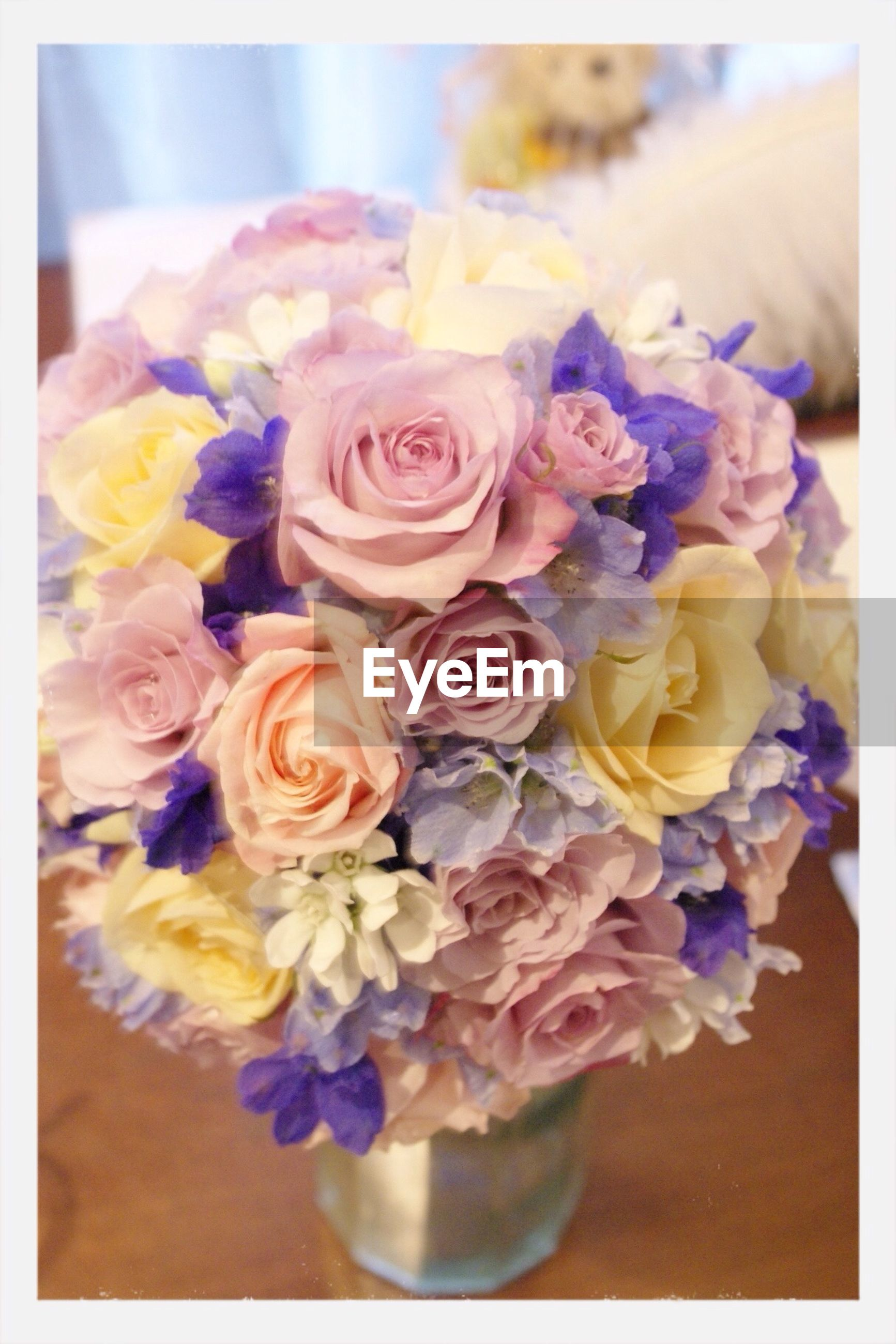 flower, indoors, freshness, petal, fragility, flower head, bouquet, transfer print, bunch of flowers, rose - flower, vase, auto post production filter, close-up, table, multi colored, still life, flower arrangement, high angle view, variation, beauty in nature