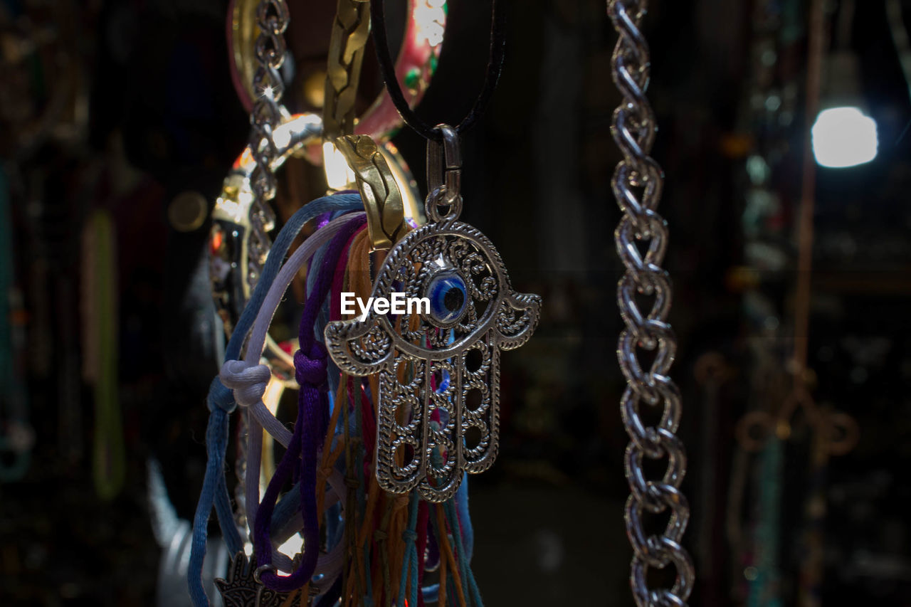 Hamsa And Jewelry Hanging For Sale At Market Stall