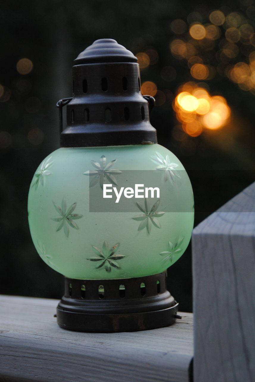 Close-Up Of Lantern On Railing