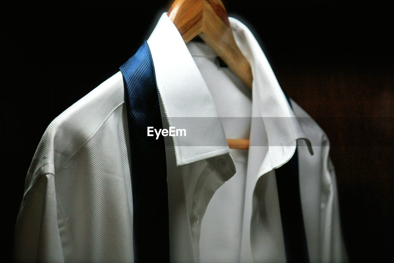 Close-up of clothes hanging against black background