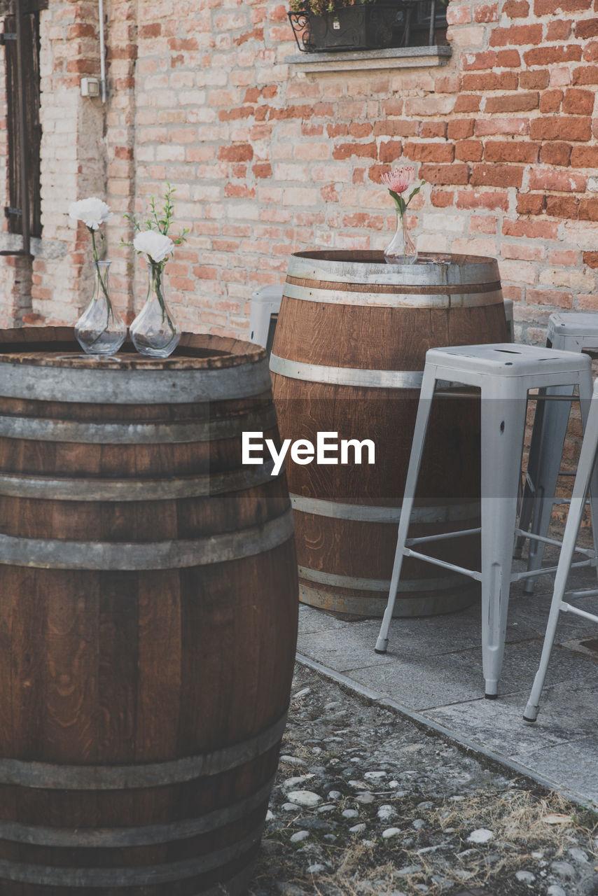 Vase on barrel at outdoors cafe