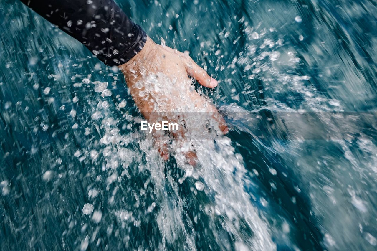swimming, water, sea, splashing, motion, outdoors, one person, speed, leisure activity, waterfront, human body part, sport, sea life, low section, sports race, day, lifestyles, nature, men, swimming pool, real people, people, adult, adults only, human hand, close-up, only men, one man only, sportsman, triathlon, humpback whale