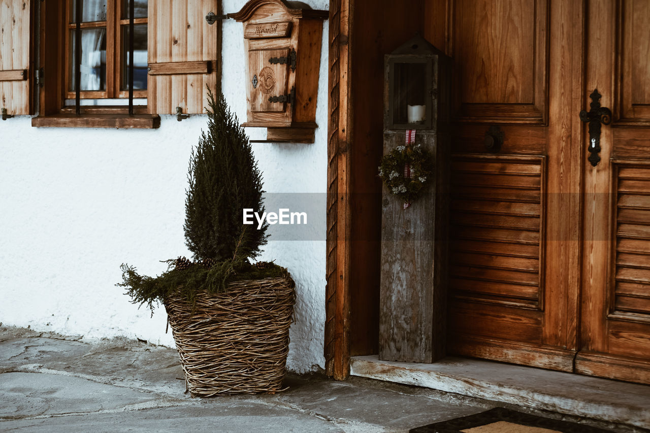wood - material, door, entrance, no people, house, architecture, built structure, building exterior, plant, building, day, outdoors, nature, decoration, brown, christmas, winter, snow