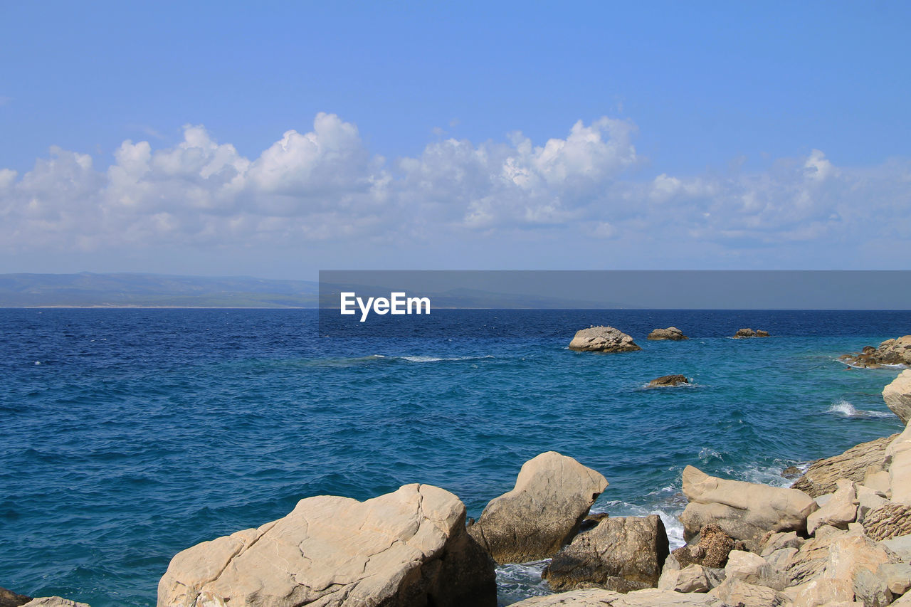 sea, water, sky, scenics - nature, beauty in nature, rock, rock - object, horizon over water, horizon, solid, tranquil scene, cloud - sky, tranquility, blue, nature, idyllic, day, non-urban scene, no people, outdoors, rocky coastline