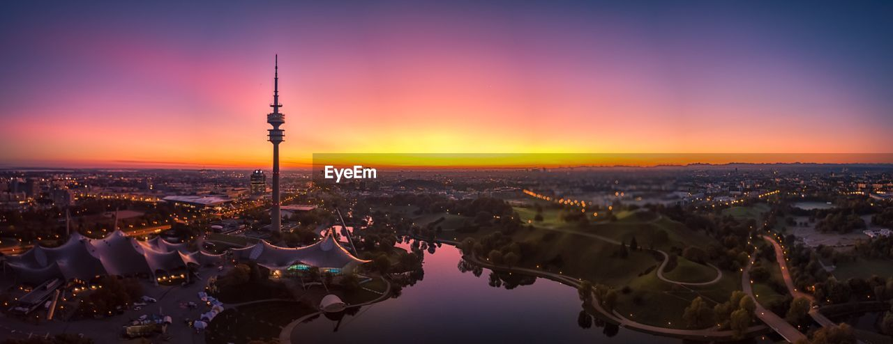 architecture, sky, built structure, sunset, building exterior, city, cityscape, travel destinations, nature, tourism, orange color, tower, building, travel, no people, tall - high, outdoors, water, spire