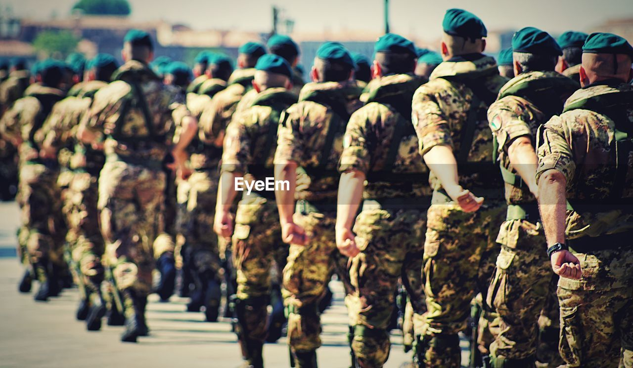 Army Soldiers Marching During Parade On Street