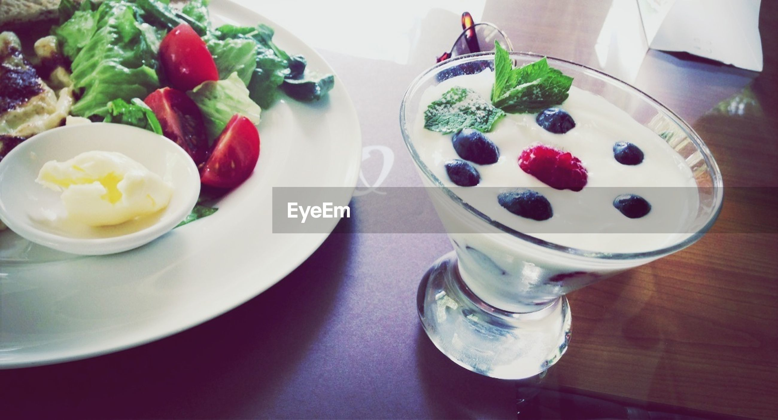 food and drink, indoors, freshness, food, table, still life, high angle view, plate, sweet food, bowl, ready-to-eat, refreshment, drink, healthy eating, dessert, indulgence, directly above, strawberry, fruit, close-up