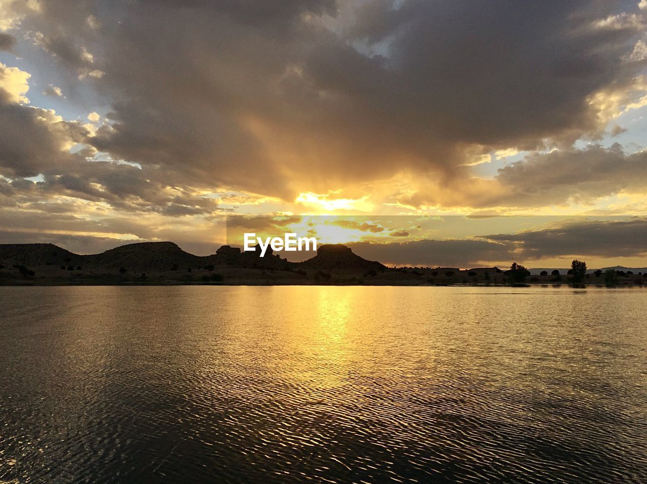sky, cloud - sky, sunset, water, scenics - nature, beauty in nature, tranquil scene, waterfront, tranquility, sea, nature, no people, mountain, idyllic, sunlight, outdoors, orange color, reflection