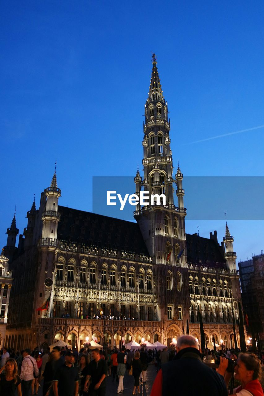 People by grand place at dusk