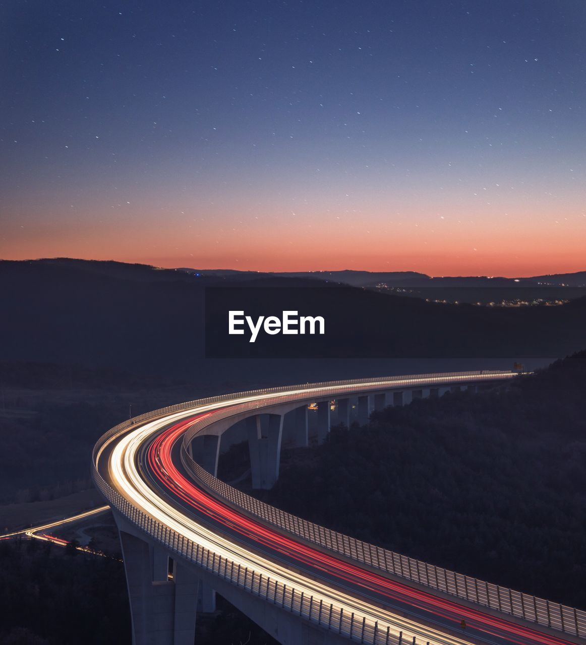 night, sky, illuminated, long exposure, road, light trail, motion, nature, mountain, scenics - nature, star - space, transportation, speed, no people, connection, high angle view, bridge, space, city, bridge - man made structure, astronomy, outdoors