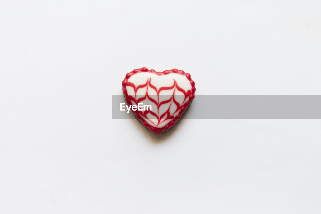 heart shape, copy space, red, studio shot, sweet food, food and drink, white background, indoors, food, love, indulgence, still life, emotion, close-up, positive emotion, single object, no people, unhealthy eating, baked, sweet, temptation, valentine's day - holiday, candy heart