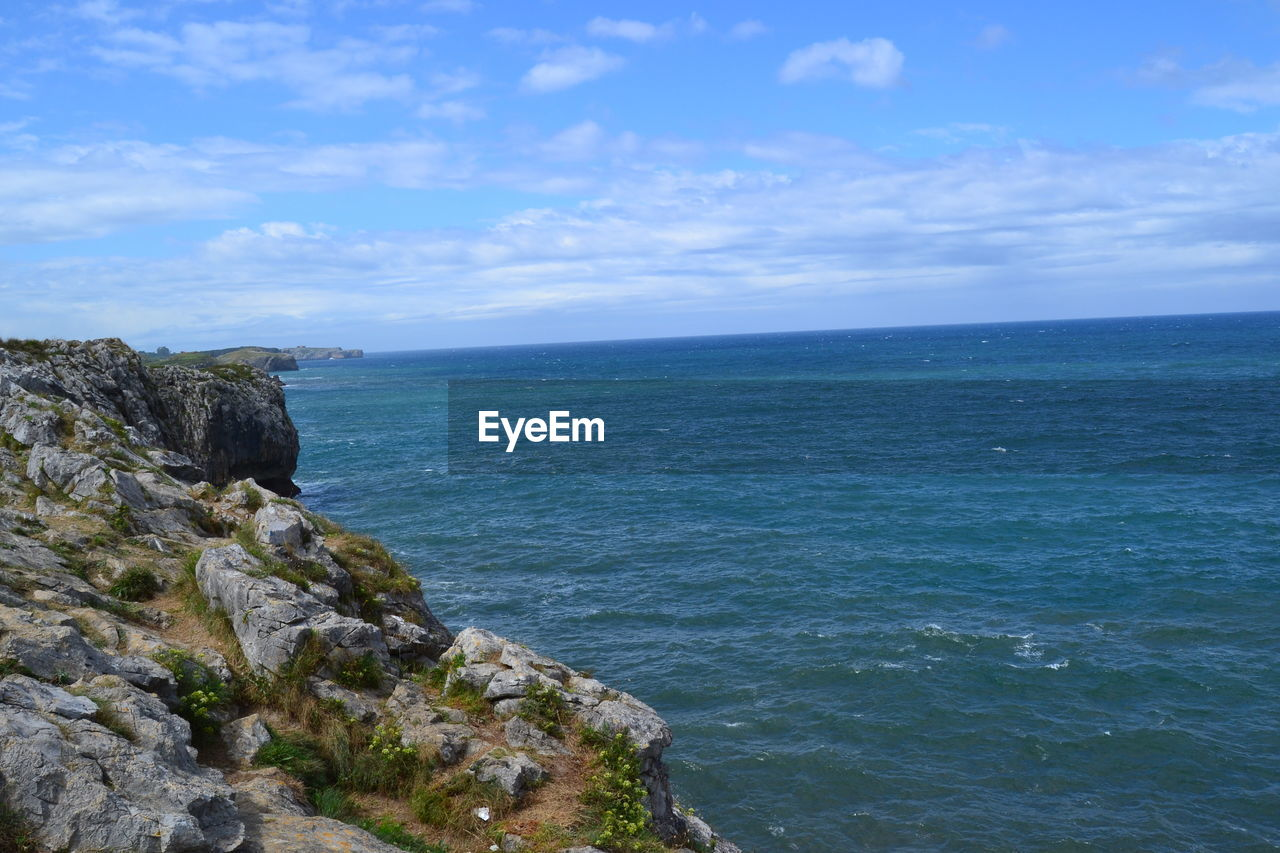sea, nature, water, sky, scenics, tranquil scene, tranquility, horizon over water, beauty in nature, rock - object, cloud - sky, outdoors, blue, day, cliff, no people, blue sky