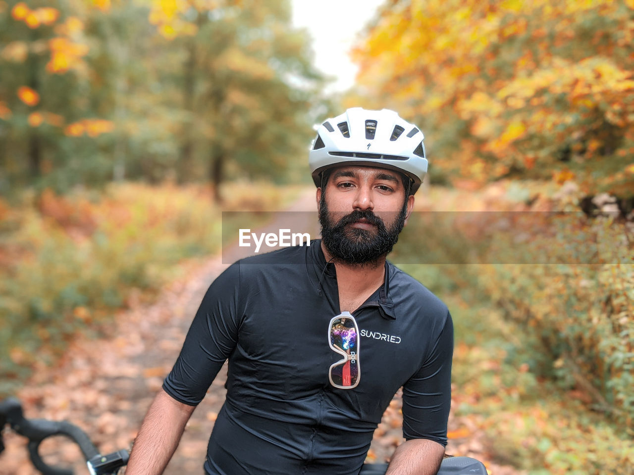 PORTRAIT OF MAN WITH BICYCLE DURING AUTUMN