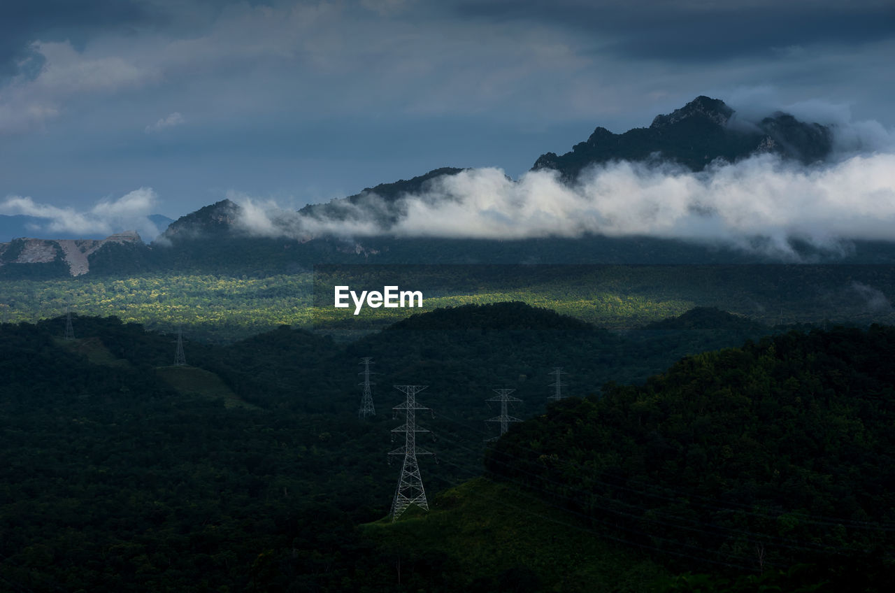 cloud - sky, sky, beauty in nature, scenics - nature, tranquil scene, environment, landscape, tranquility, nature, no people, plant, mountain, non-urban scene, land, tree, fog, electricity pylon, technology, electricity, outdoors