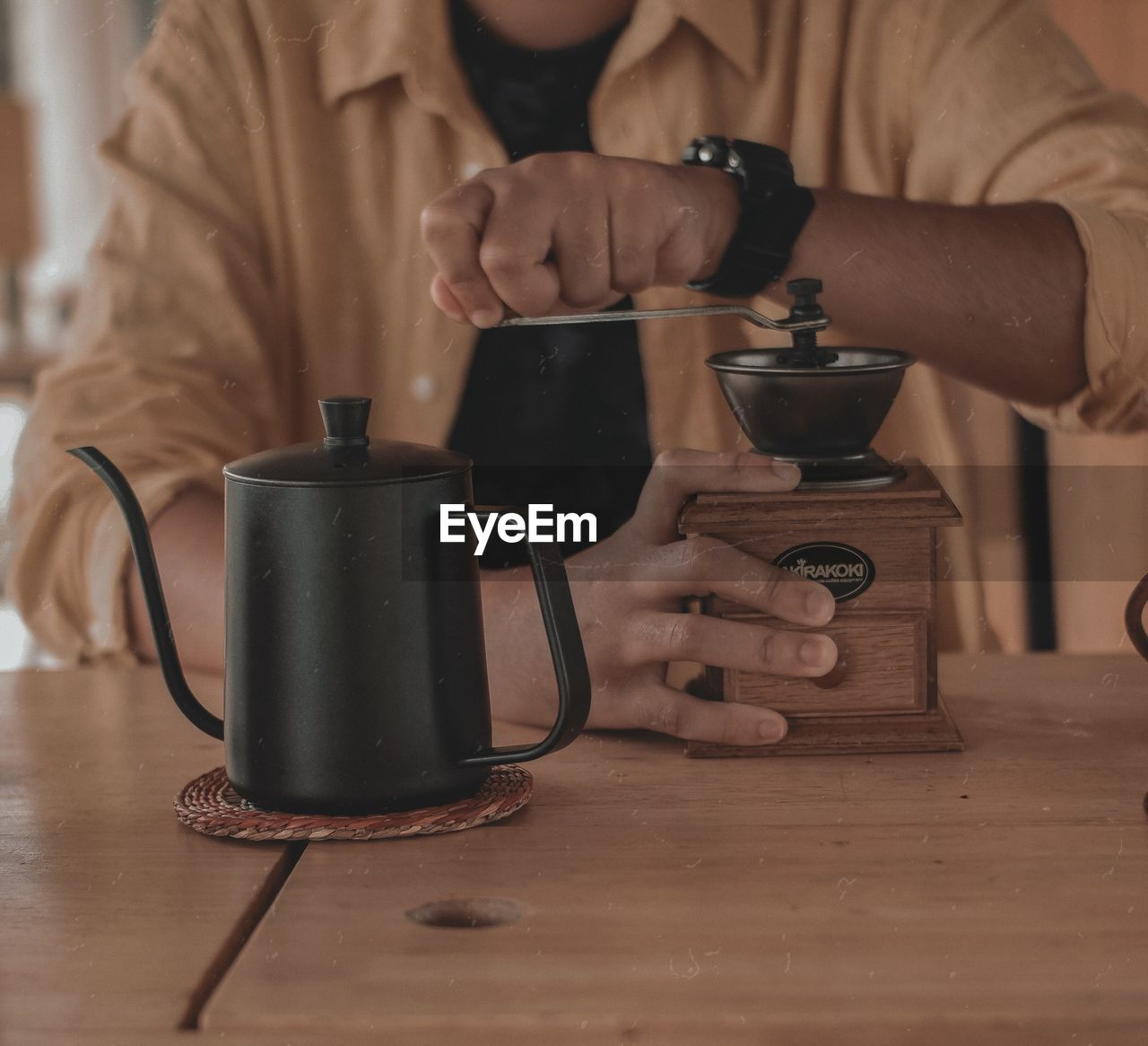 CLOSE-UP OF COFFEE CUP ON TABLE WITH TEXT