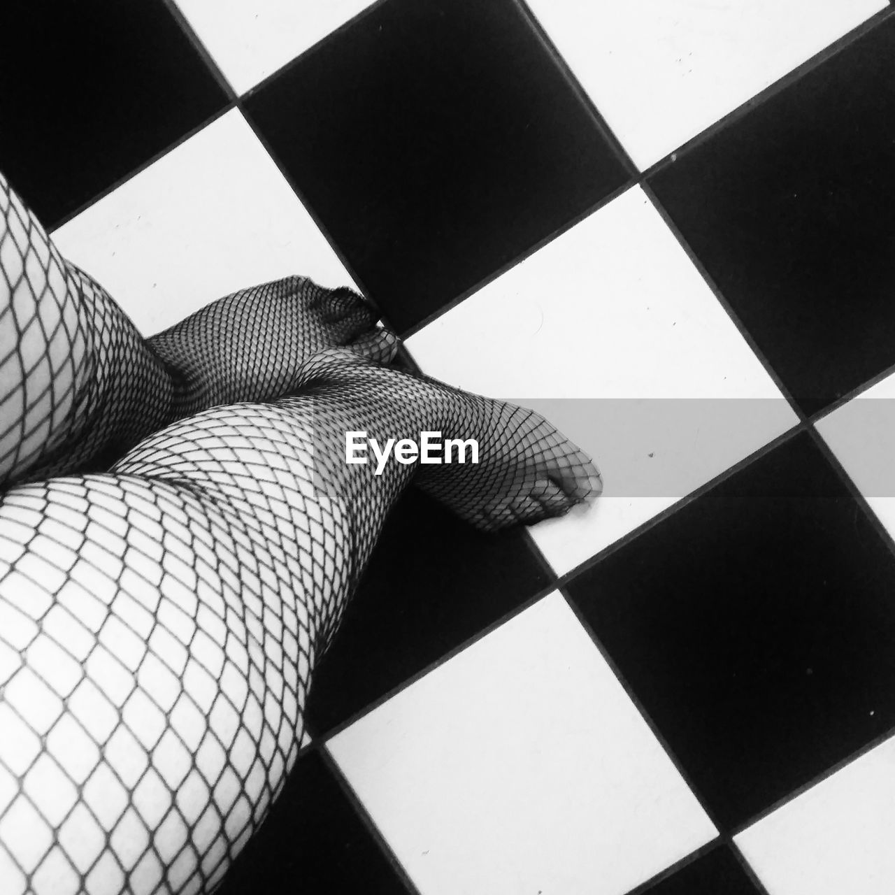 human body part, human leg, body part, one person, low section, real people, flooring, indoors, tiled floor, high angle view, tile, checked pattern, stockings, women, pattern, leisure activity, lifestyles, relaxation, limb, human limb, human foot