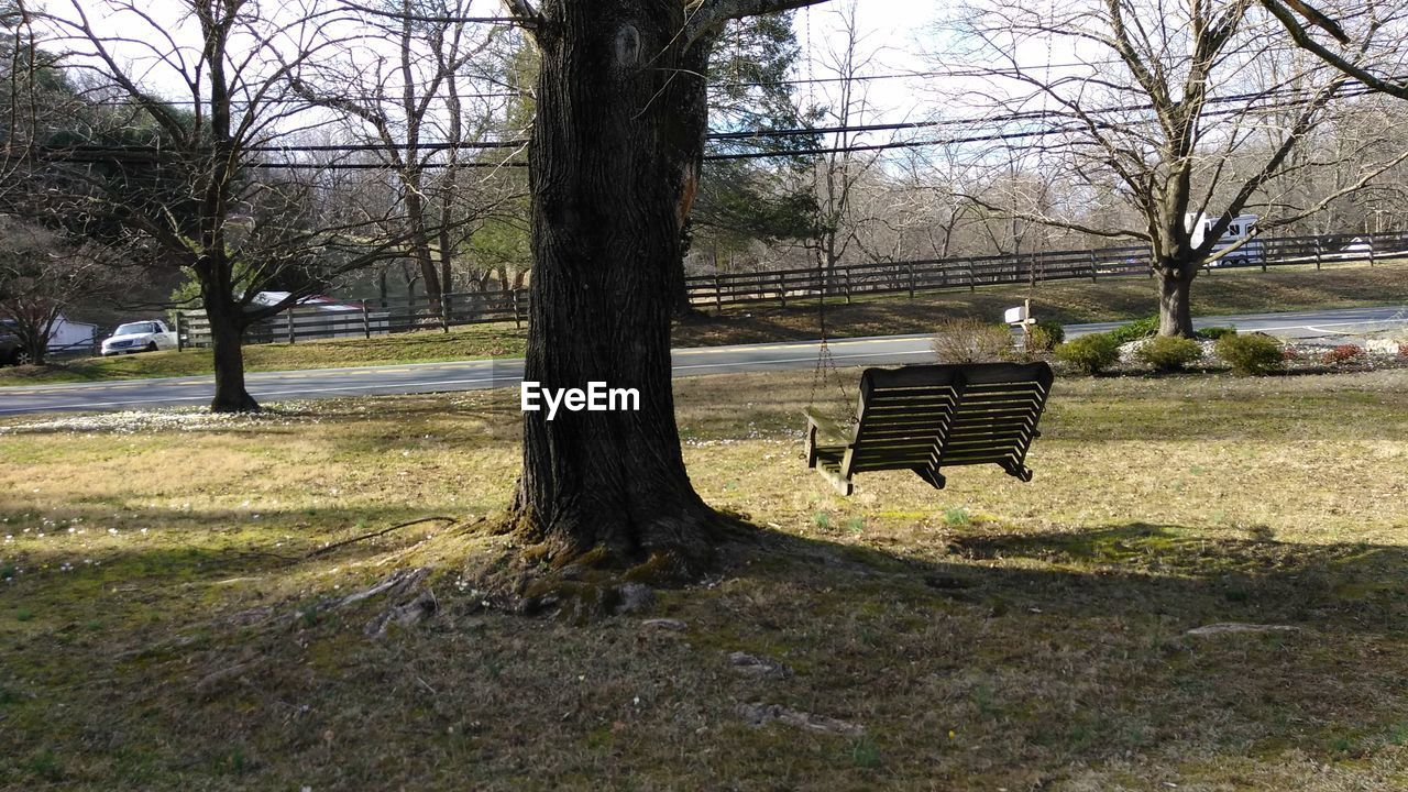 tree, park - man made space, bare tree, absence, no people, day, nature, seat, grass, outdoors, branch, landscape, beauty in nature, sky