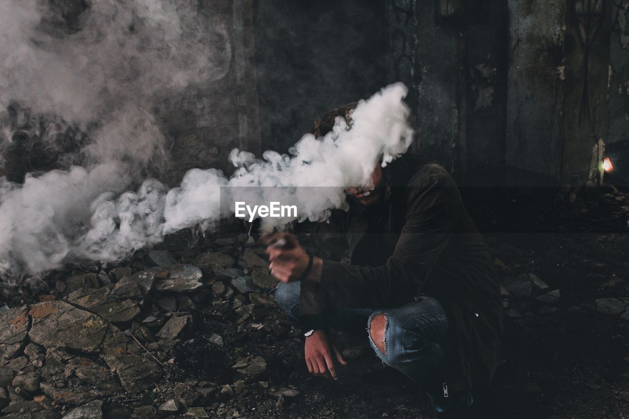 Man Holding Smoke Bomb