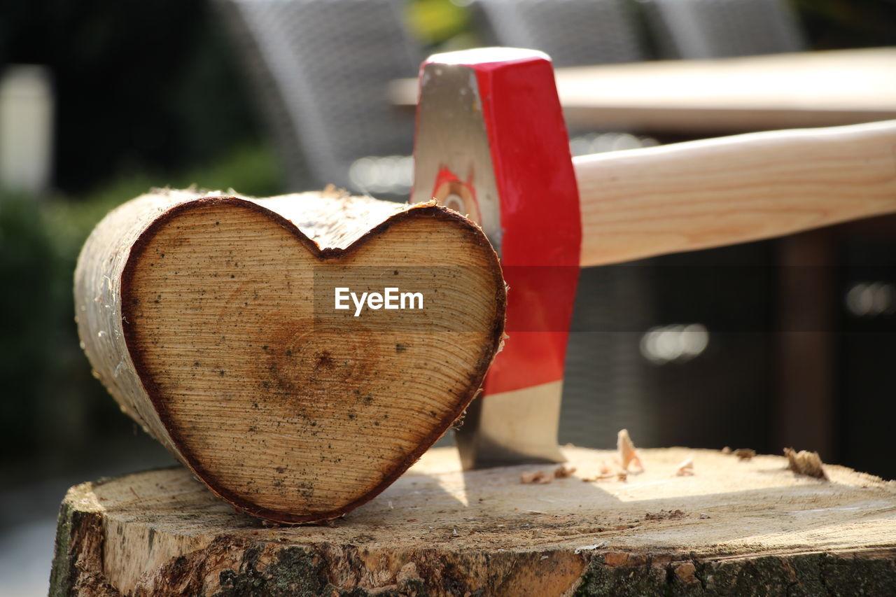 Close-up of heart shape log
