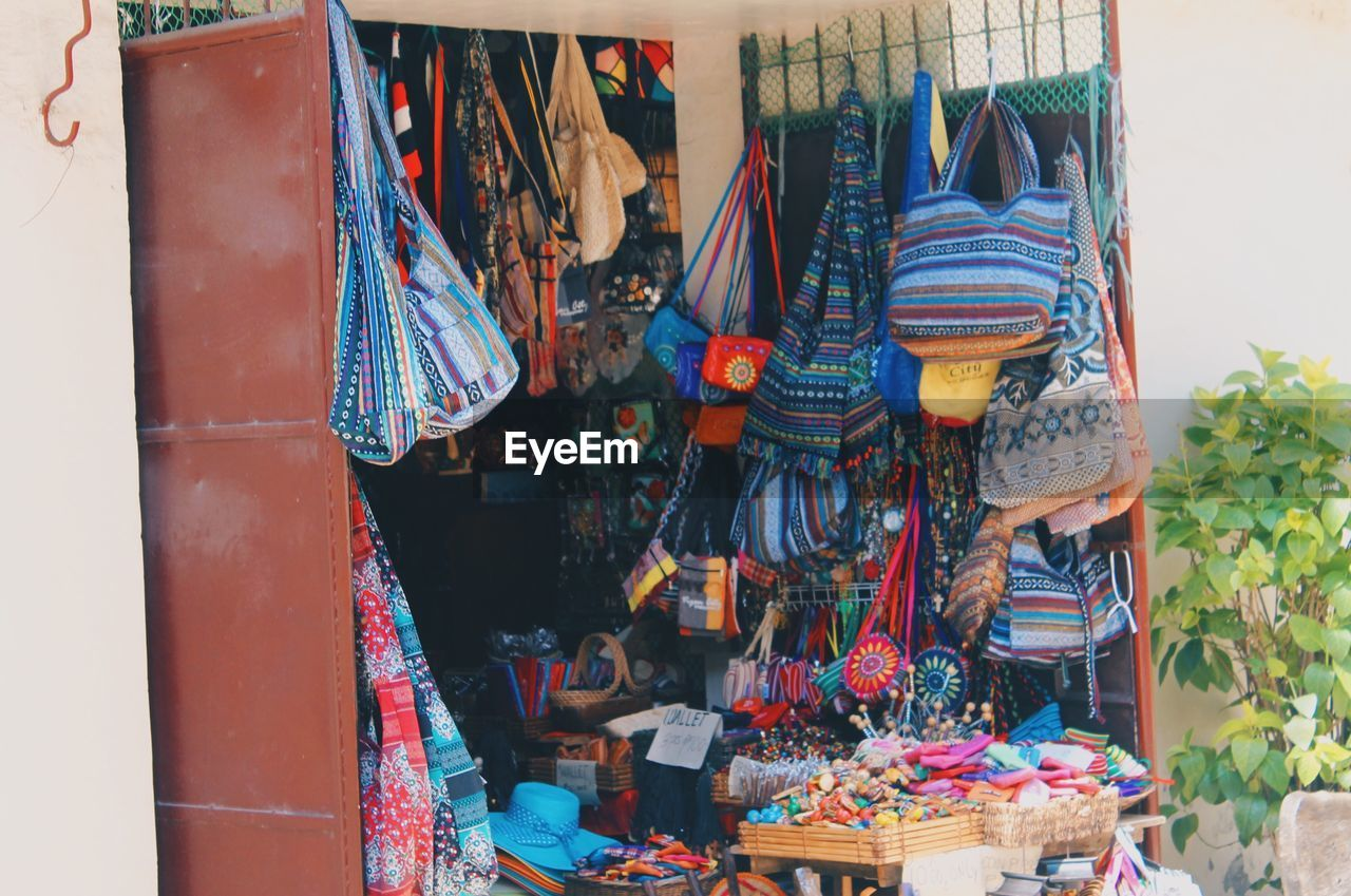 for sale, hanging, market, retail, day, market stall, outdoors, multi colored, no people, variation, choice, large group of objects, close-up