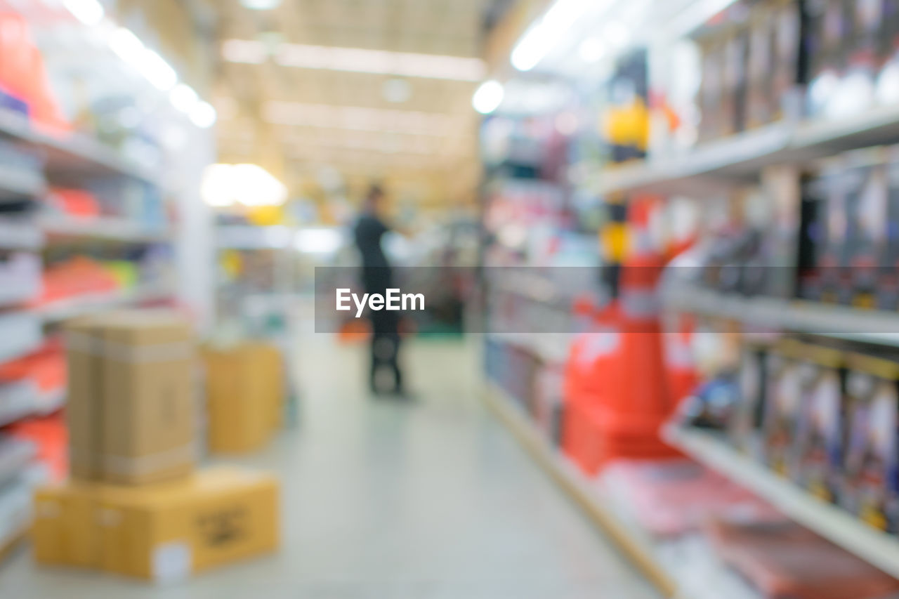 retail, shelf, indoors, store, choice, shopping, supermarket, selective focus, one person, consumerism, customer, food and drink, variation, incidental people, market, food, shopping cart, business, lifestyles, groceries, aisle