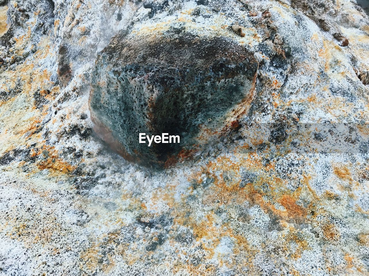 rock, rock - object, solid, textured, full frame, close-up, no people, day, backgrounds, rough, nature, geology, outdoors, pattern, rock formation, beauty in nature, natural pattern, weathered, mineral, high angle view, lichen, layered, eroded
