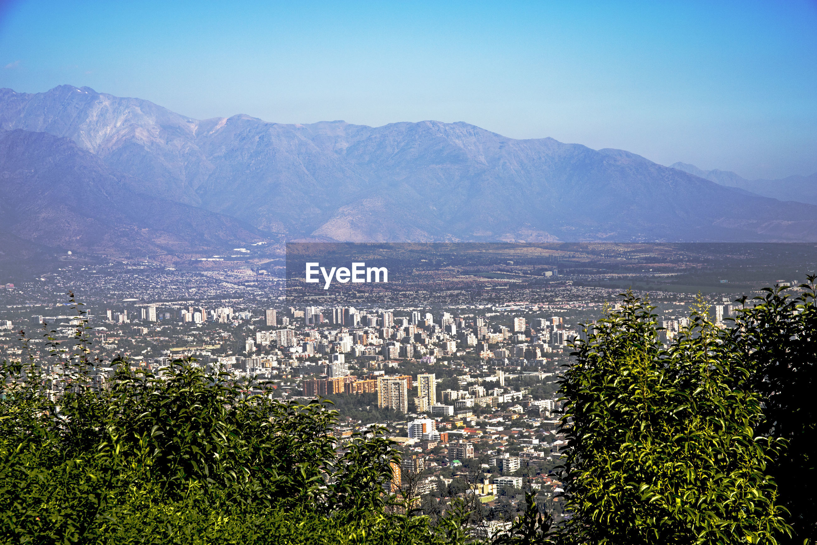 mountain, cityscape, architecture, built structure, building exterior, city, day, high angle view, no people, outdoors, mountain range, tree, clear sky, nature, sky