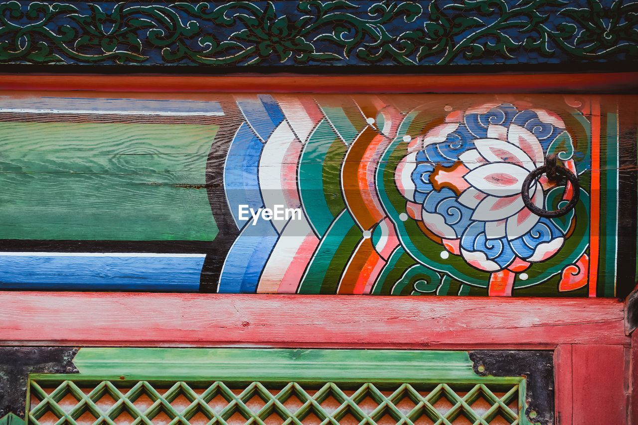 multi colored, no people, pattern, art and craft, creativity, wall - building feature, day, wood - material, design, built structure, architecture, indoors, close-up, craft, floral pattern, graffiti, animal representation, representation, clock, ornate, mural