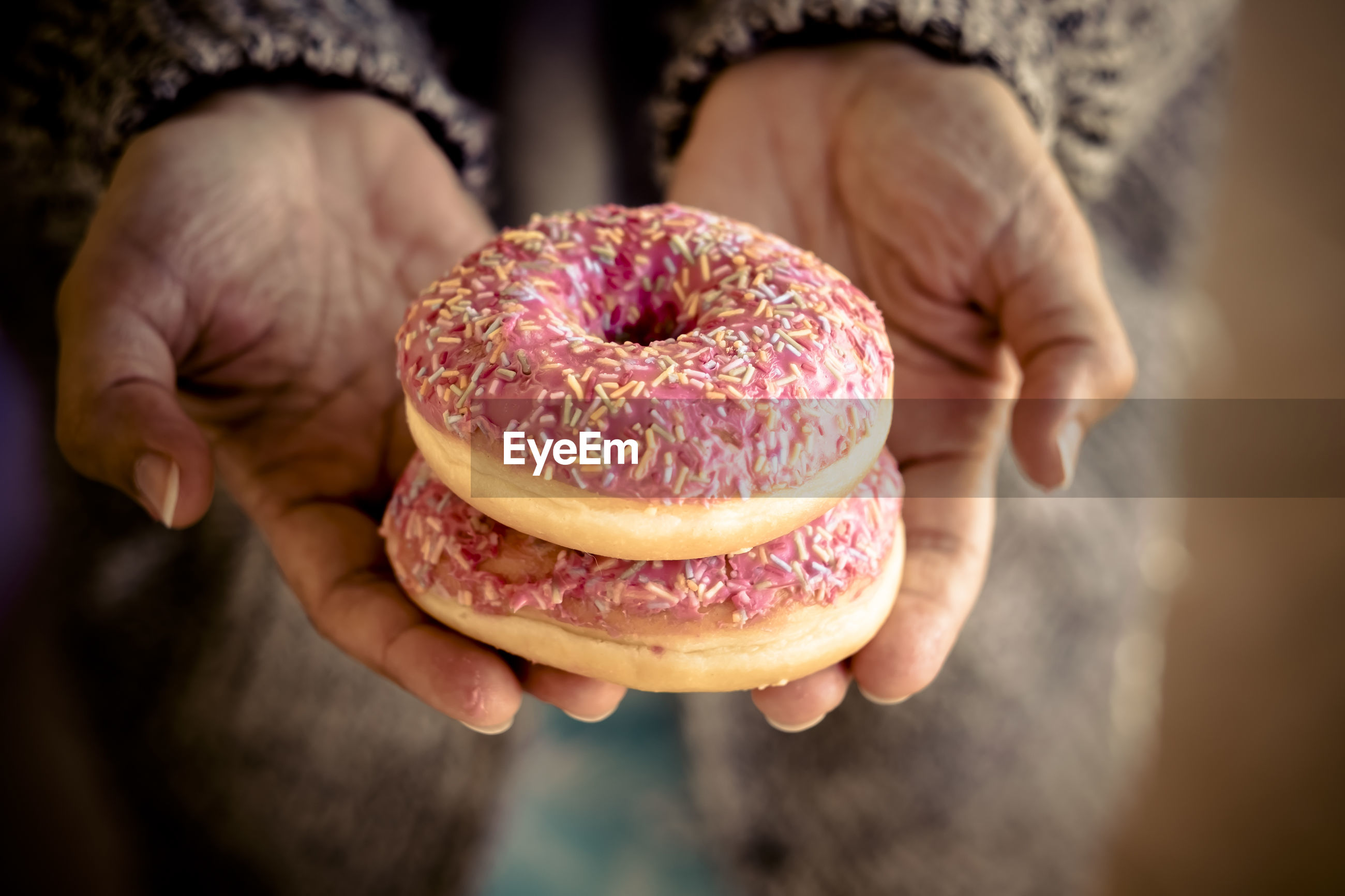 Midsection of woman holding donuts
