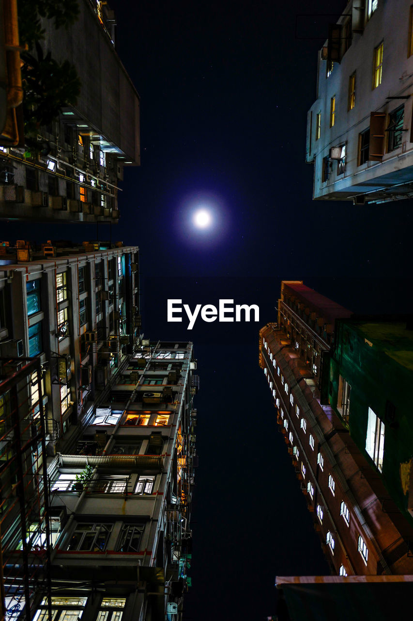 building exterior, illuminated, night, architecture, built structure, city, building, moon, no people, sky, low angle view, residential district, moonlight, full moon, outdoors, nature, city life, tall - high, lighting equipment, modern, skyscraper, apartment