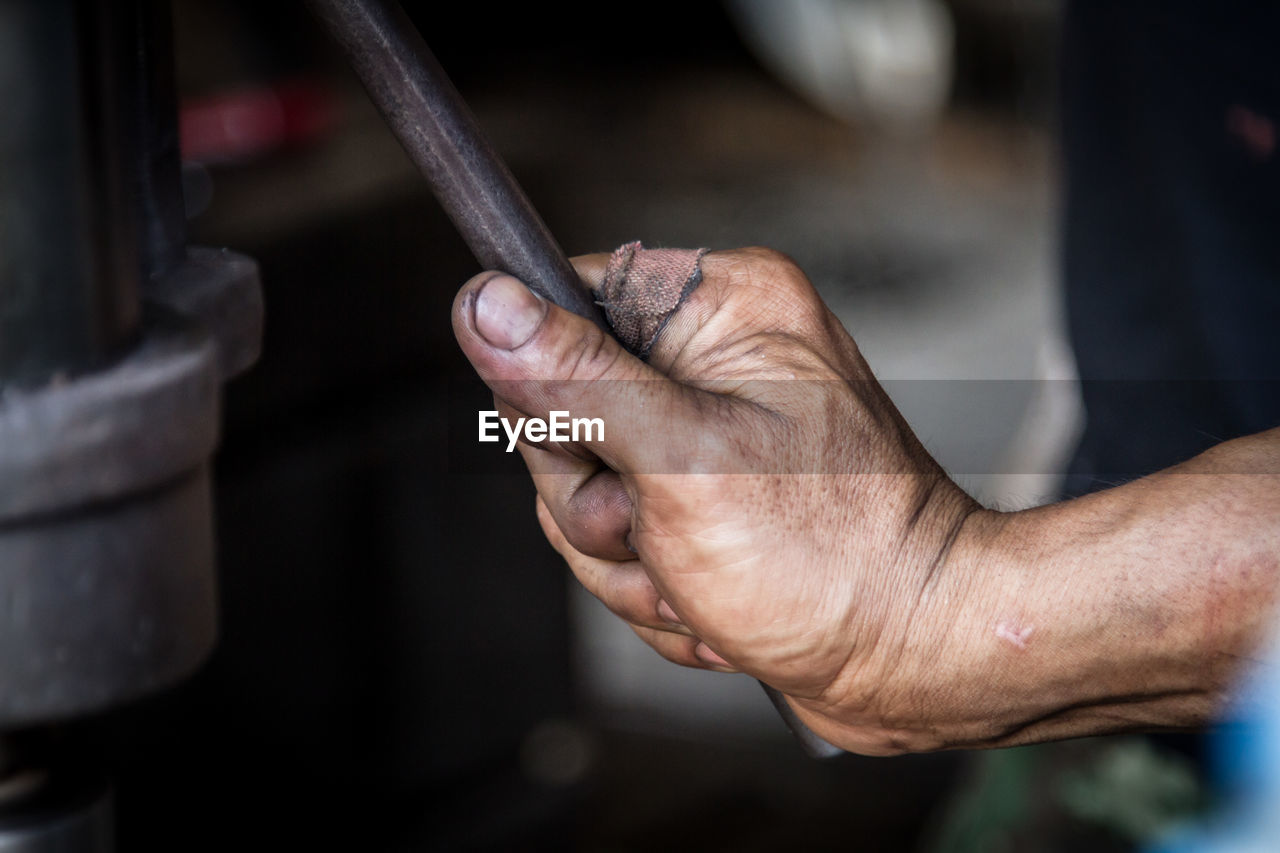 Cropped Hand Of Manual Worker Holding Machinery