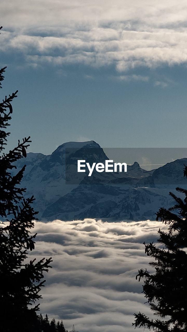 cloud - sky, sky, mountain, beauty in nature, scenics - nature, tranquil scene, tranquility, tree, nature, plant, no people, mountain range, non-urban scene, idyllic, environment, outdoors, landscape, day, cold temperature, snowcapped mountain, mountain peak, range
