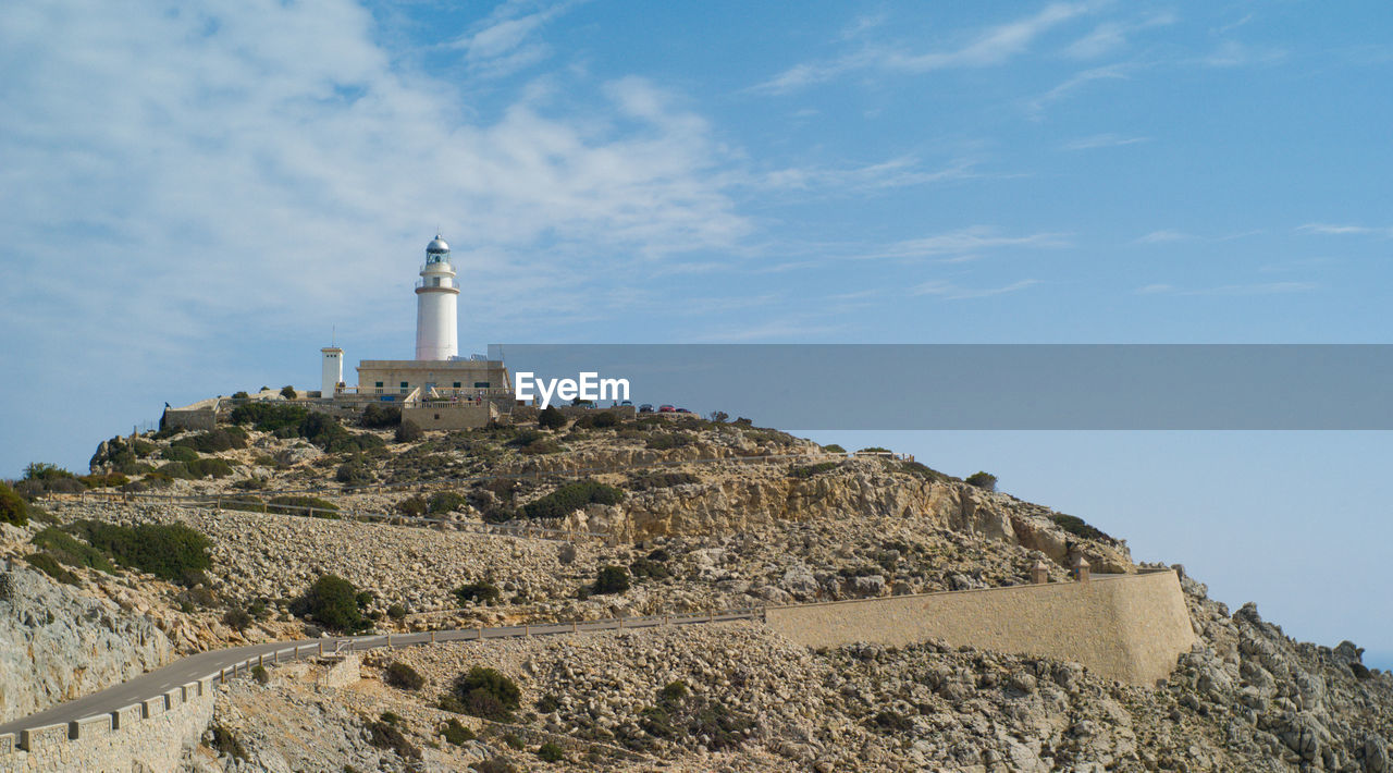 Low angle view of formentor lighthouse at majorca against sky
