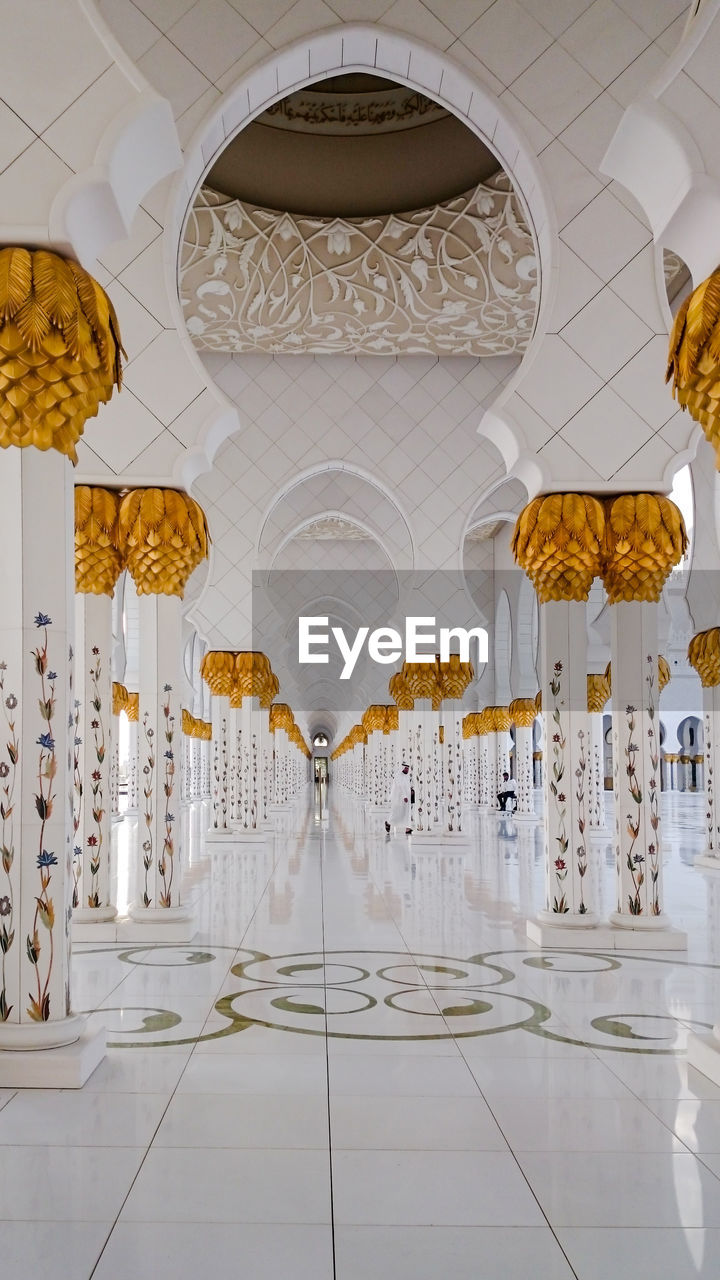 indoors, architecture, built structure, arch, ceiling, hanging, building, flooring, no people, lighting equipment, place of worship, religion, architectural column, chandelier, belief, spirituality, decoration, the past, tile, tiled floor, ornate, luxury