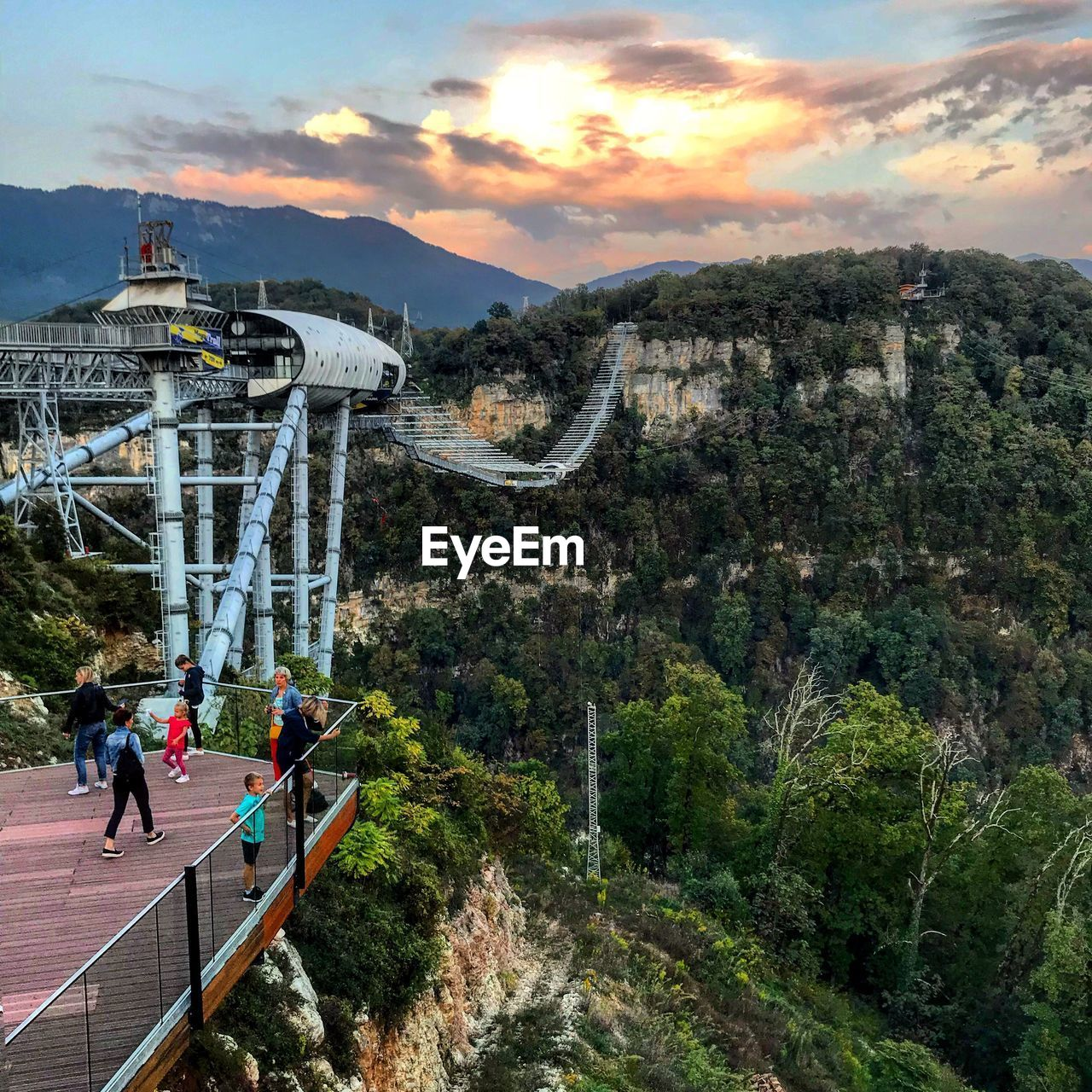 architecture, built structure, mountain, group of people, sky, real people, nature, cloud - sky, men, plant, leisure activity, lifestyles, tree, beauty in nature, travel, bridge, people, travel destinations, women, scenics - nature, outdoors, mountain range, bridge - man made structure