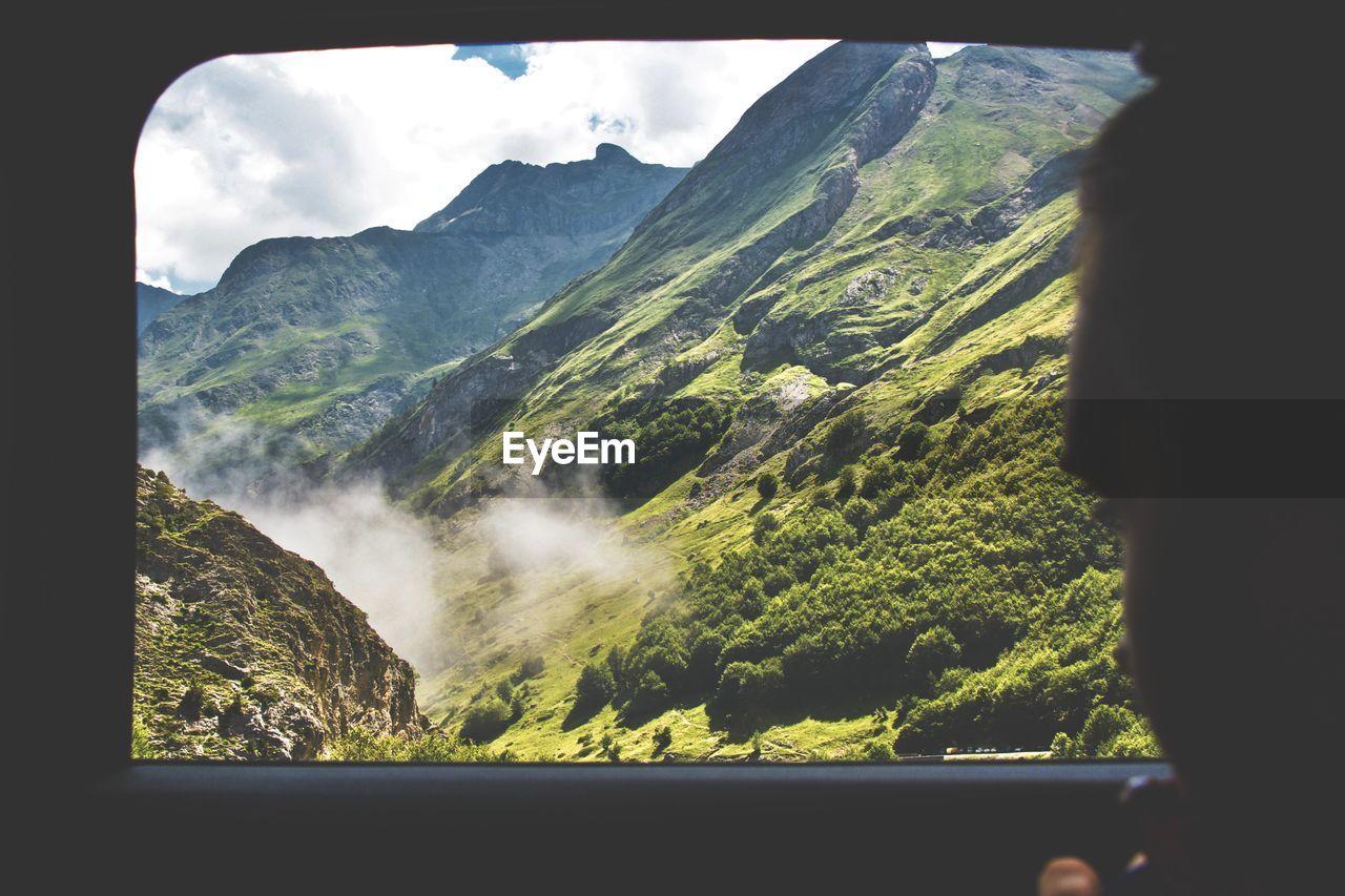 VIEW OF MOUNTAIN THROUGH WINDOW