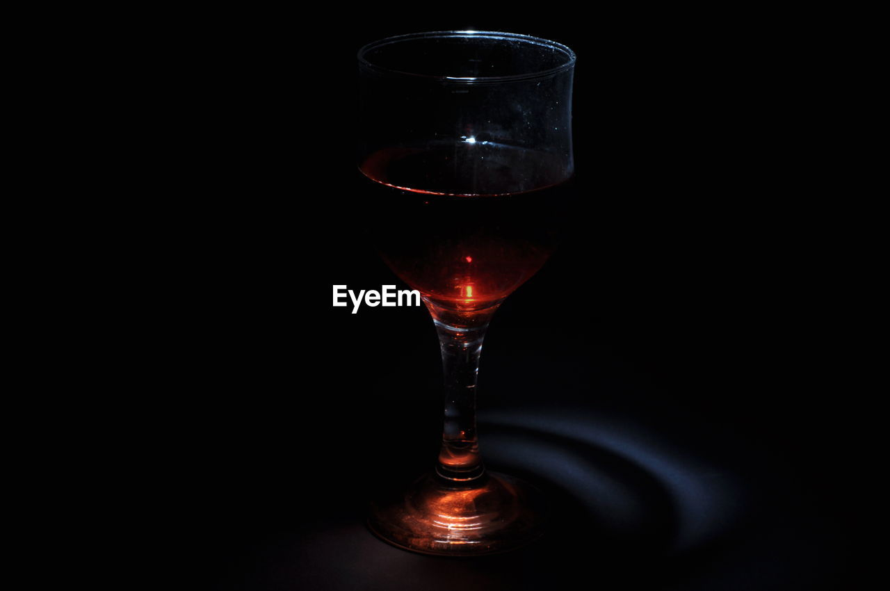glass, refreshment, drink, alcohol, food and drink, wineglass, wine, still life, no people, indoors, black background, close-up, transparent, glass - material, studio shot, copy space, freshness, drinking glass, household equipment, table, red wine