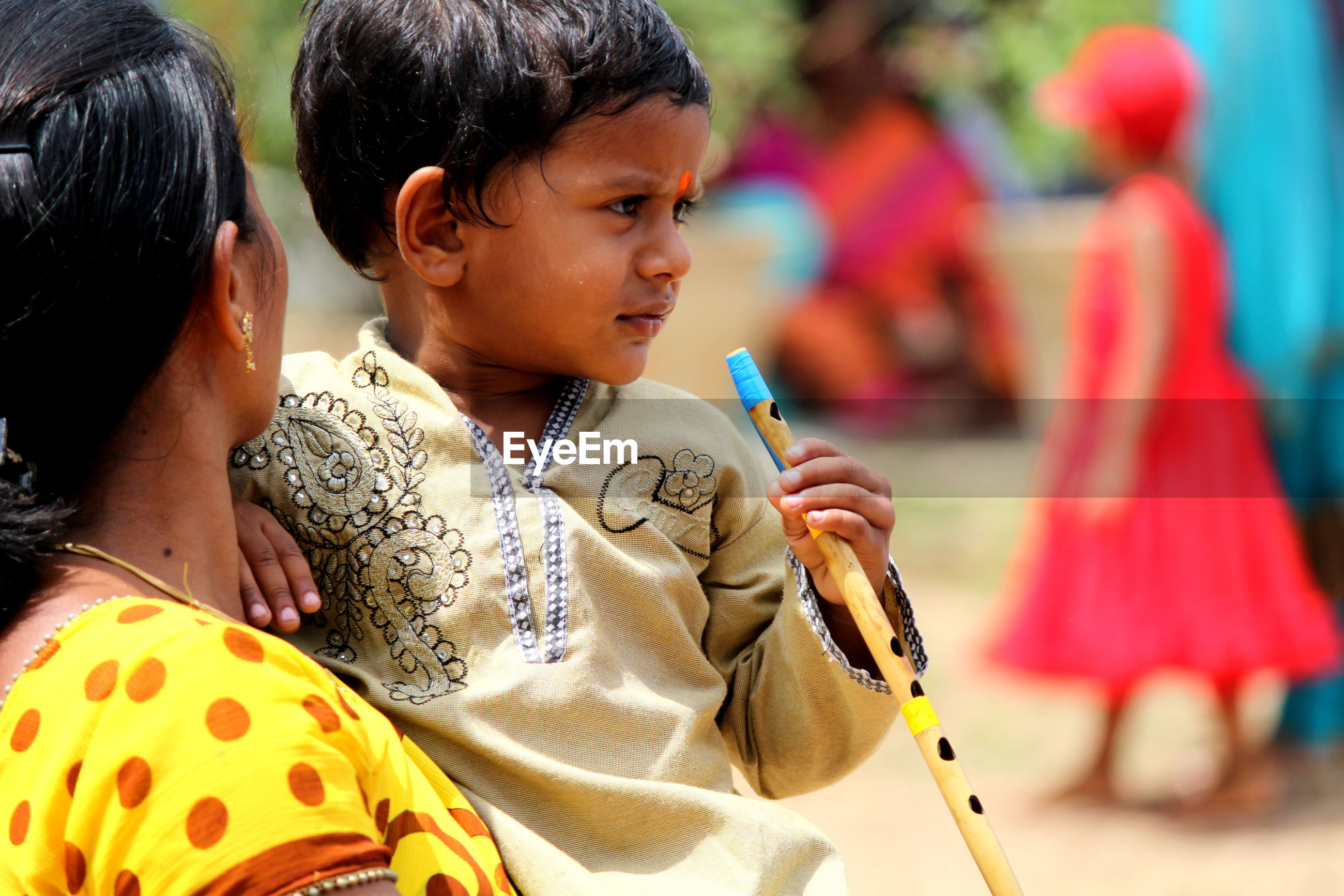 Boy with mother holding flute