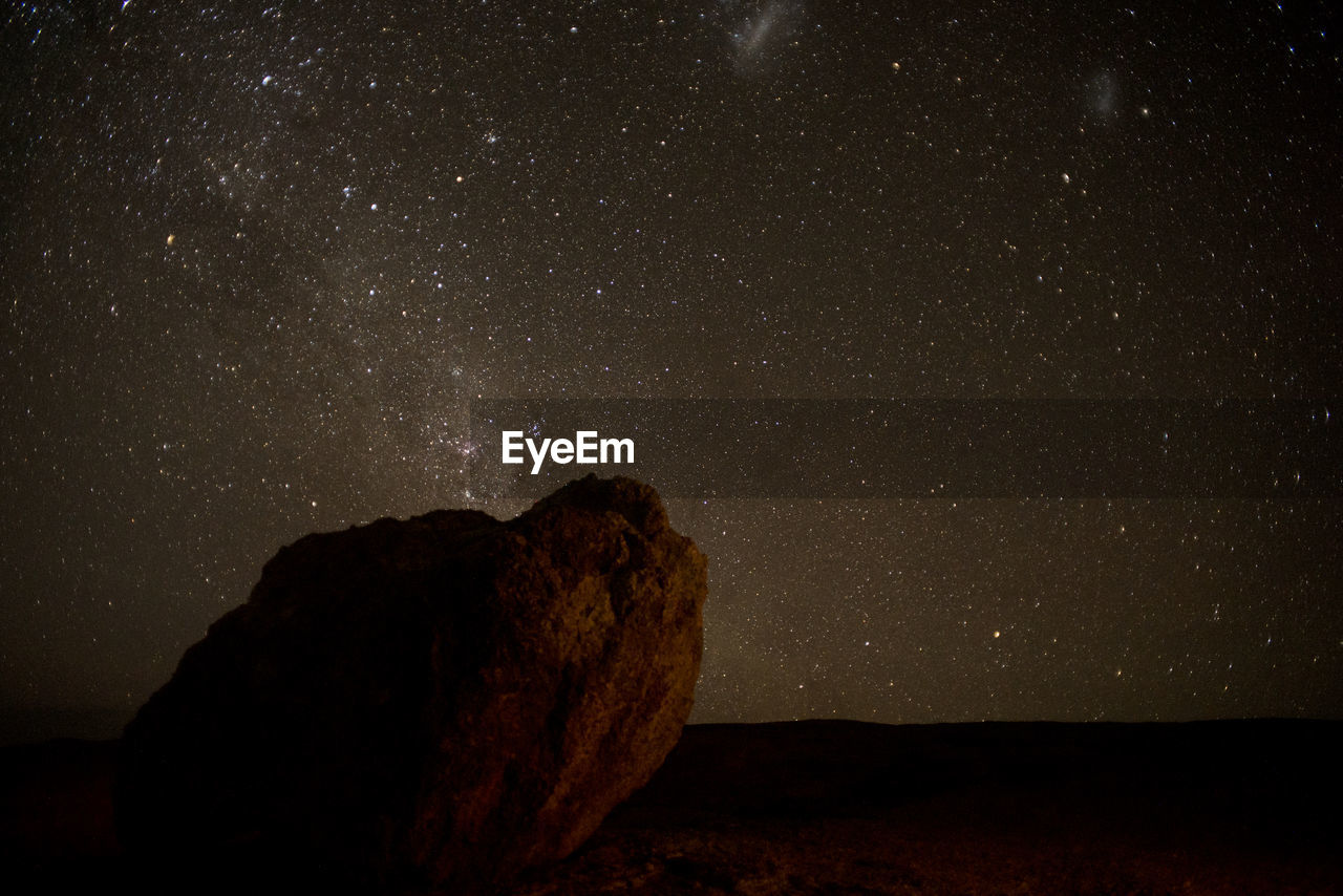 sky, night, star - space, space, astronomy, rock, scenics - nature, rock - object, rock formation, beauty in nature, nature, no people, galaxy, solid, star, tranquil scene, tranquility, star field, land, environment, outdoors, milky way
