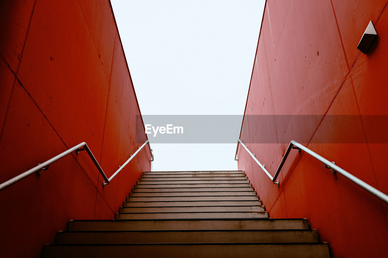 staircase, steps and staircases, architecture, low angle view, railing, built structure, direction, the way forward, sky, clear sky, no people, day, nature, building exterior, moving up, wall - building feature, building, outdoors, diminishing perspective, empty