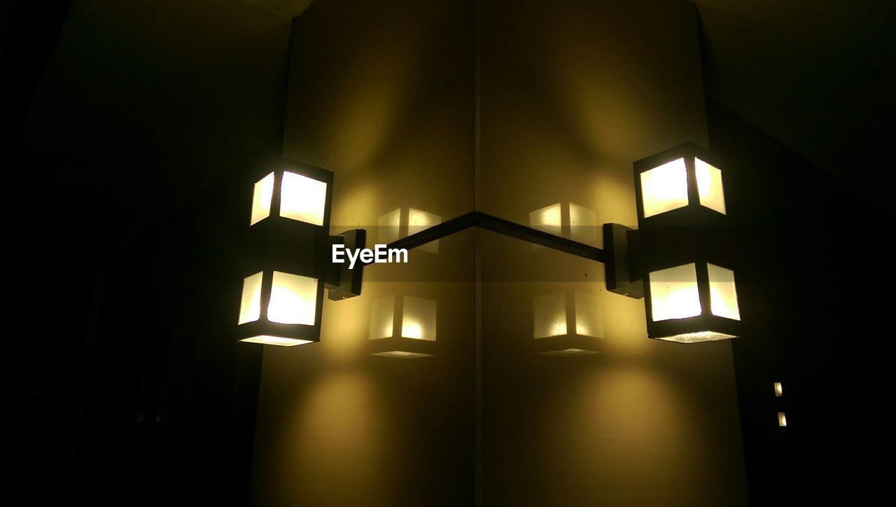 Low angle view of illuminated lights on wall