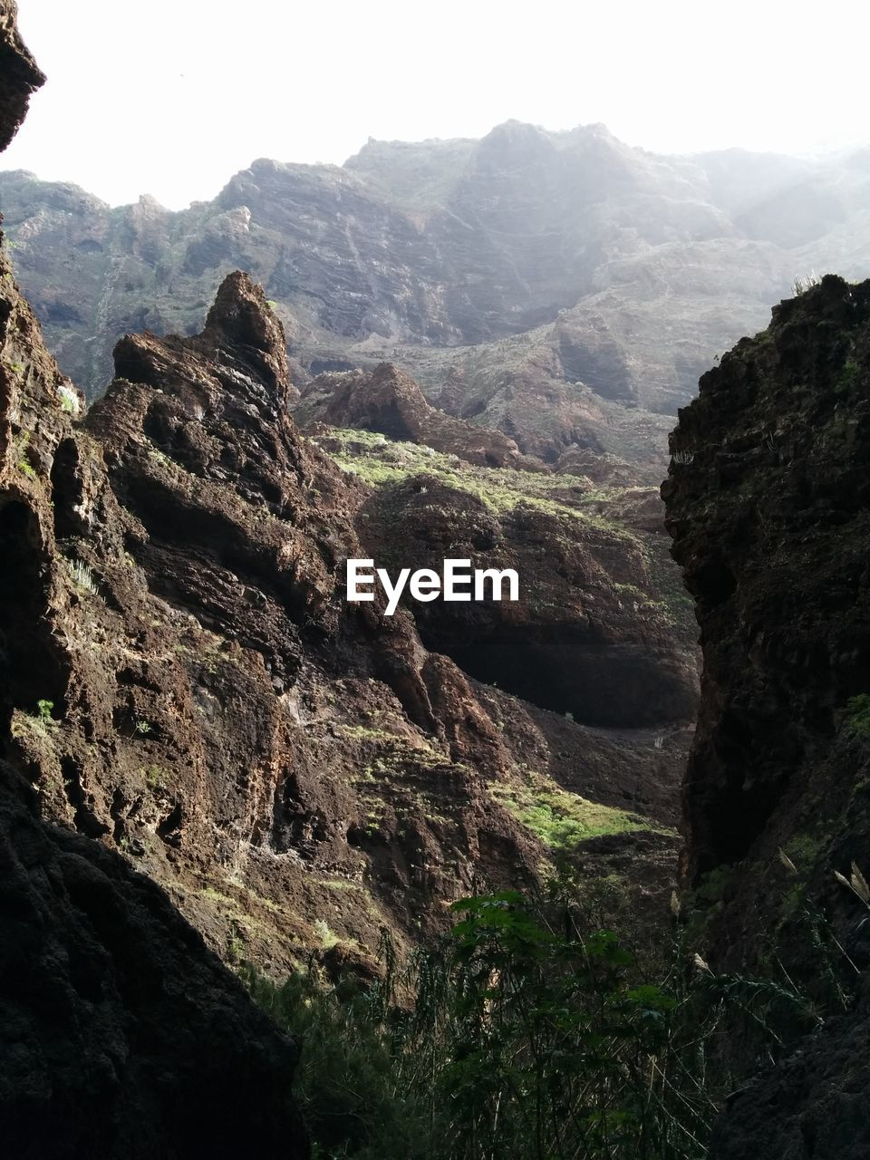mountain, rock, beauty in nature, nature, mountain range, scenics - nature, rock - object, sky, tranquility, tranquil scene, solid, day, environment, no people, rock formation, landscape, rough, physical geography, outdoors, geology, formation, mountain peak, eroded, high