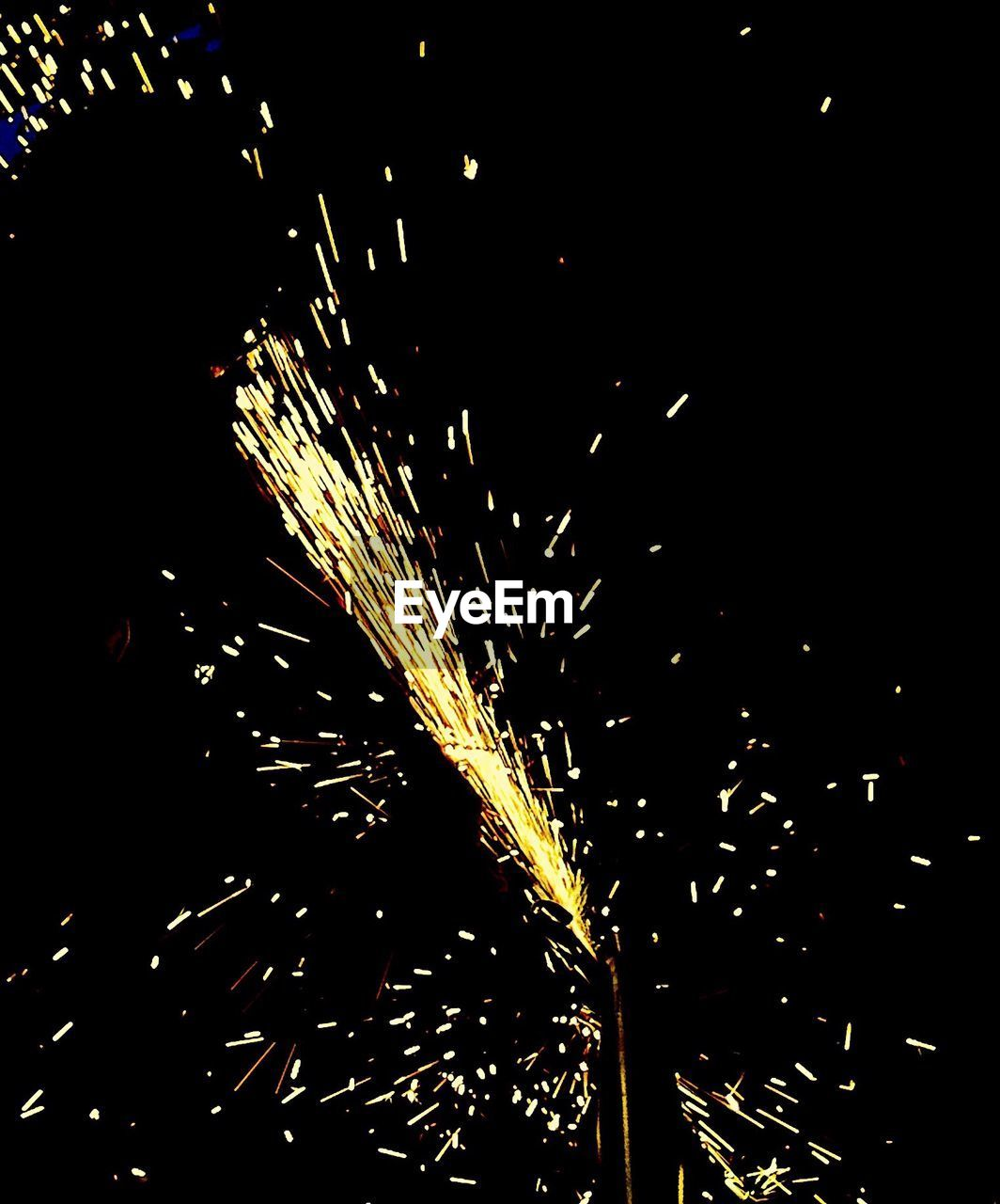 night, sparks, celebration, long exposure, firework - man made object, firework display, illuminated, exploding, motion, glowing, blurred motion, arts culture and entertainment, event, sparkler, firework, outdoors, real people, diwali, one person, sky, people