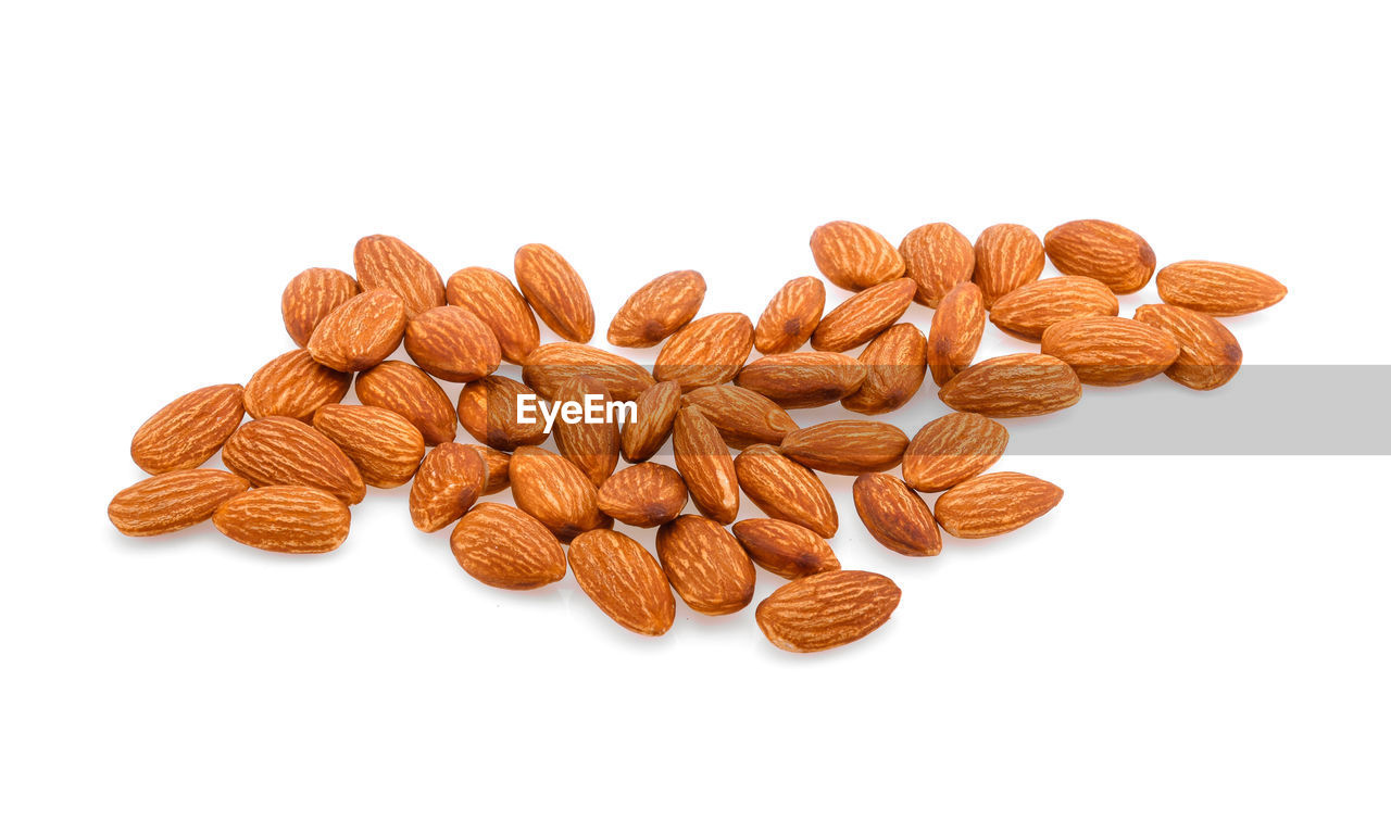 white background, studio shot, close-up, brown, food and drink, indoors, cut out, nut, large group of objects, nut - food, food, almond, still life, wellbeing, no people, healthy eating, freshness, copy space, group, high angle view, snack
