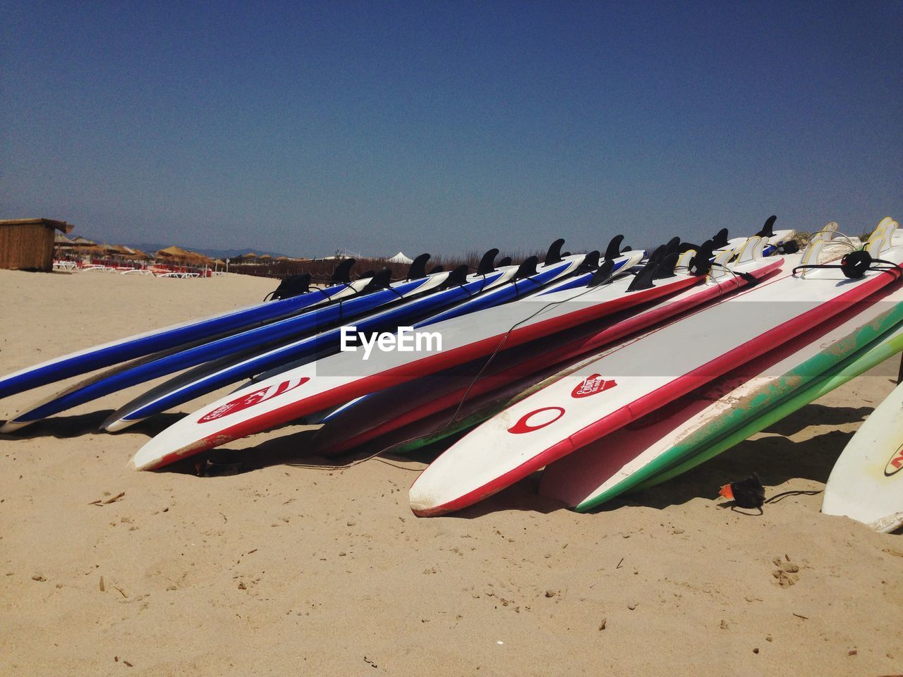 sand, beach, in a row, day, outdoors, no people, mode of transport, nautical vessel, multi colored, clear sky, sky, nature