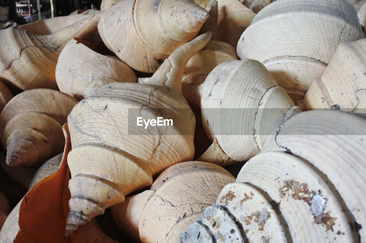 full frame, backgrounds, large group of objects, close-up, stack, abundance, no people, still life, textured, day, pattern, heap, wood - material, detail, nature, indoors, timber, sunlight, firewood