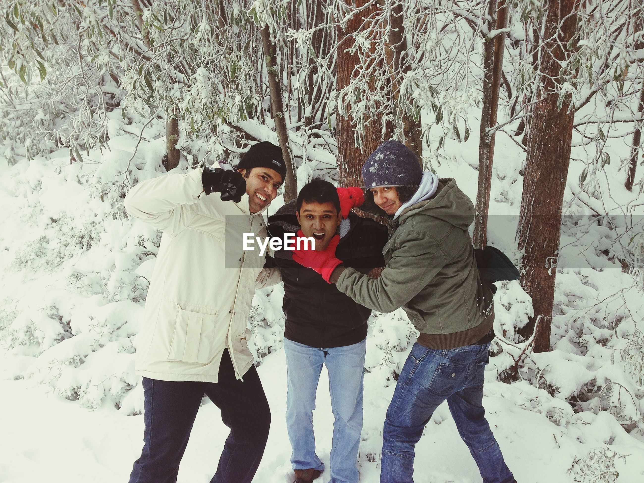 lifestyles, winter, leisure activity, cold temperature, snow, casual clothing, togetherness, full length, standing, bonding, season, warm clothing, love, walking, front view, men, person