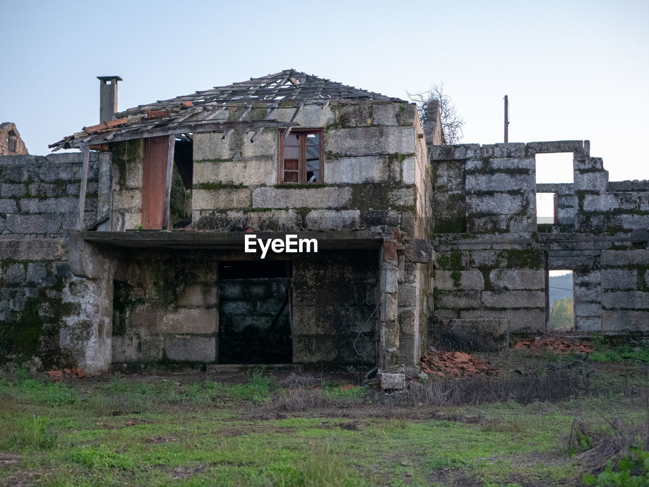 architecture, built structure, building exterior, abandoned, sky, building, nature, old, day, damaged, no people, clear sky, plant, obsolete, run-down, weathered, house, grass, field, outdoors, deterioration, stone wall, ruined