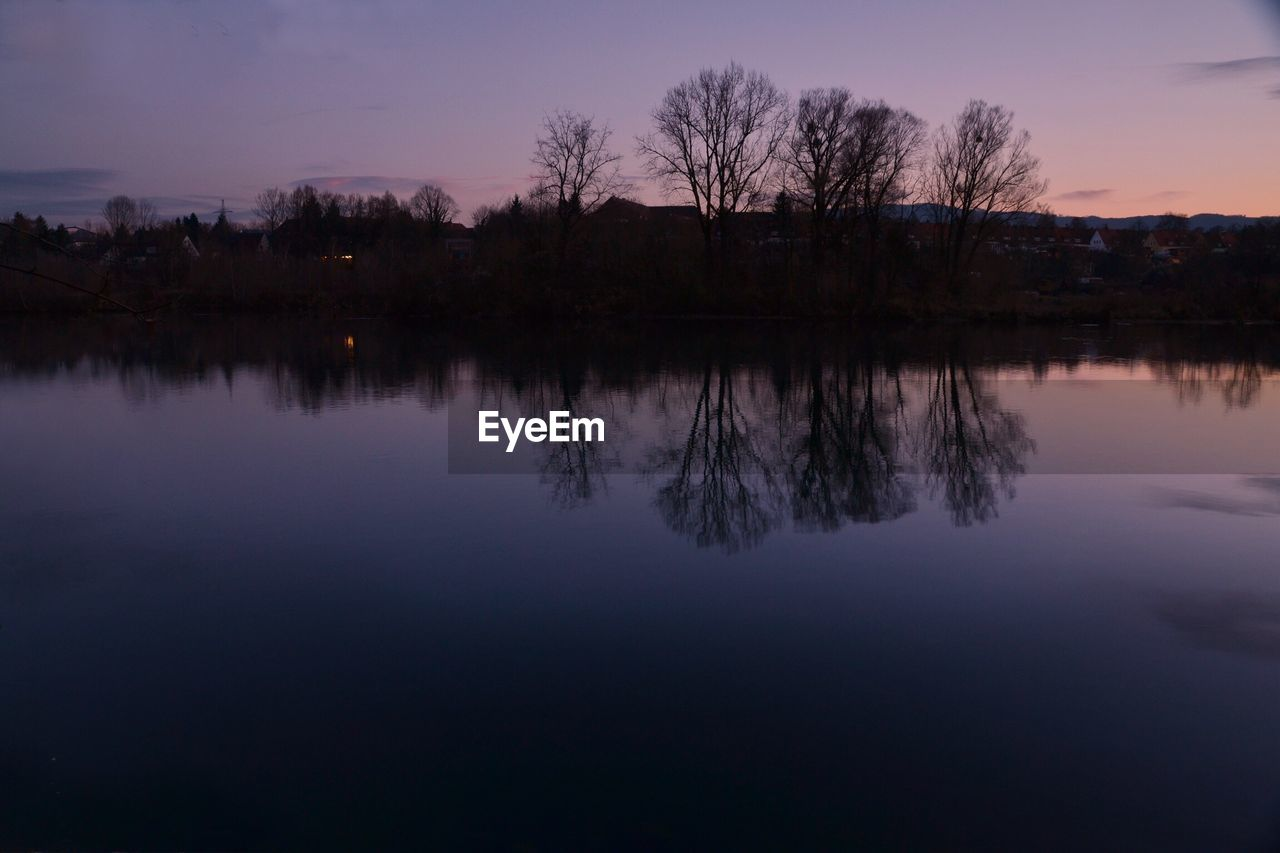 reflection, water, lake, sunset, tree, nature, silhouette, tranquil scene, tranquility, sky, beauty in nature, scenics, no people, outdoors, waterfront, landscape, day